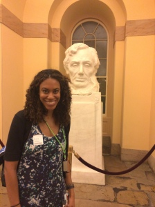 Jessica stands with Lincoln bust