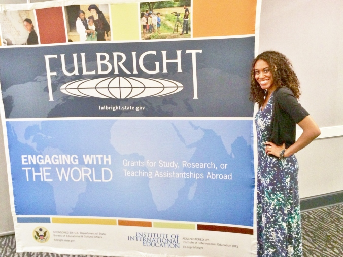 Jessica Stands by Fulbright sign