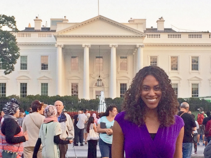 Jessica stands by white house