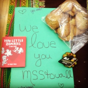 Picture of a card and cookies given by students