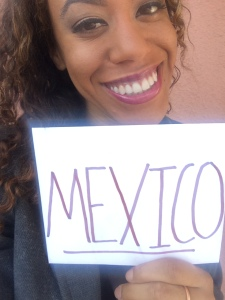Picture of Jess holding up a sign of Mexico